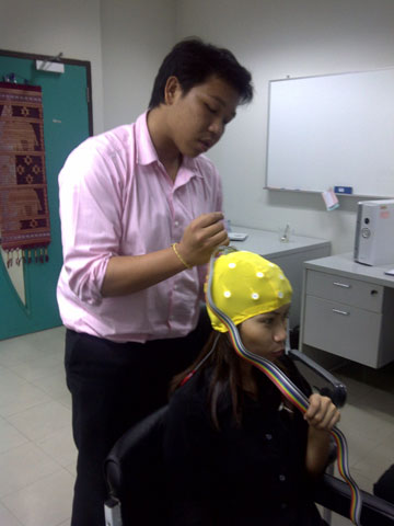 Filling electro cap with gel by graduate students