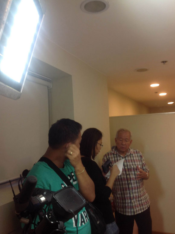 Dr Guan briefing GMA TV interviewer
