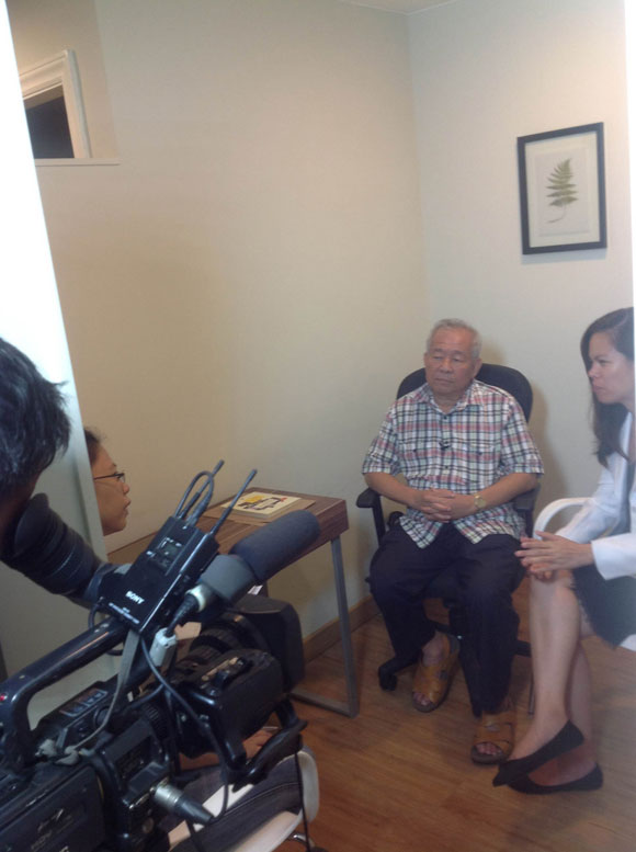 Dr Joseph Guan and Dr Cheryl Ramirez being interviewed